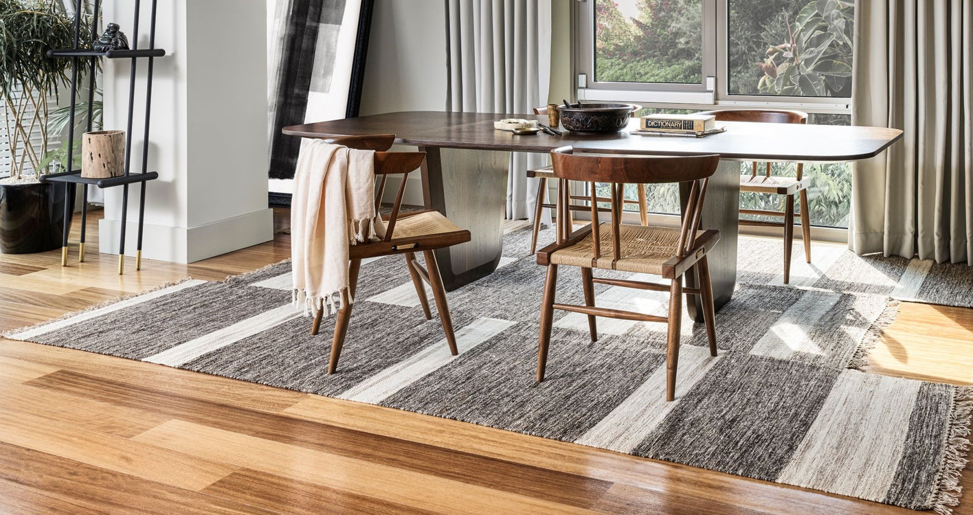 Asymmetric rug under dining table
