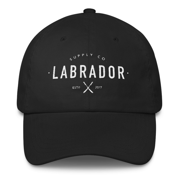 Classic black dad hat with white Labrador Supply Co. logo stitched on front.