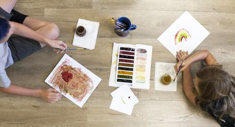 kids painting with DIY natural watercolor paints using eatable ingredients
