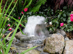 HydroFlush self-cleaning backwash system clean the small waterfall filter for you.