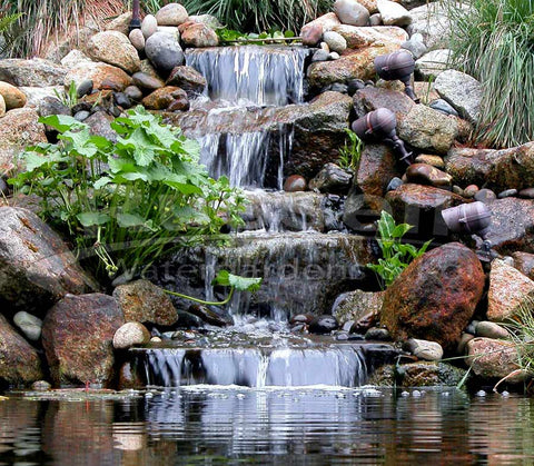 The Marlin Hydro Vortex medium waterfall filter creates beautiful and easy to maintain water garden ponds.