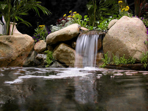 Water garden pond built with an Ahi Hydro Vortex™ small waterfall filter.