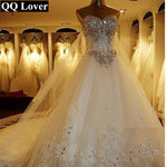 2018 New Luxury Big Train Wedding Dress Sexy Crystals Beaded Bridal Gown Custom made Plus Size Wedding Gown