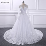 YiWuMenSa vestidos de novias Sexy see through wedding dress 2017 Long Sleeves Bridal Wedding gowns Long Train Ball gown dresses