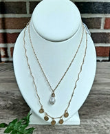 Gold disc layering necklace