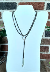 Silver lariat with circle and point drop