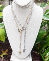 Link chain lariat necklace with oval loop and stone drop