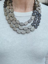 Load and play video in Gallery viewer, Grey Hardwood Oval and Bronzite Flower Necklace