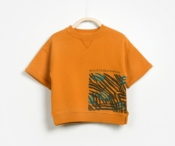 Round neck orange jumper with be a little wild everyday front print made from cotton front shot