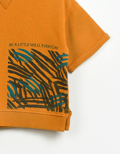 Close up shot of round neck orange jumper with be a little wild everyday front print made from cotton