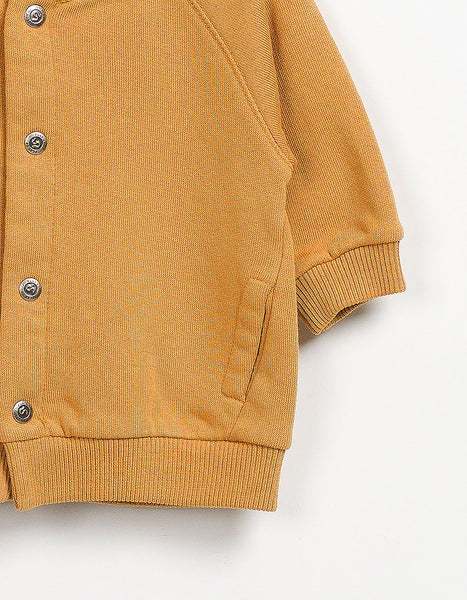 Baby Boy Cotton Bomber Jacket In Bright Orange Close Up Front Shot