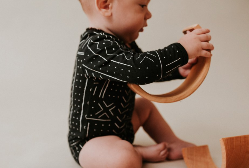 Baby wearing the organic bamboo mudcloth onsie