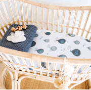 A beautiful cane bassinet with a watercolour bassinet fitted sheet in 100% organic cotton