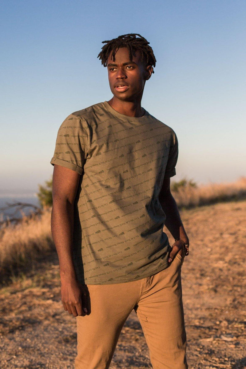 The All-Over Slogan Tee In Sage Green - Stellies Authentic Clothing