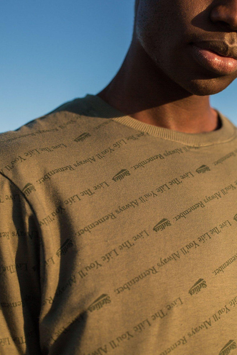 The All-Over Slogan Tee In Sage Green