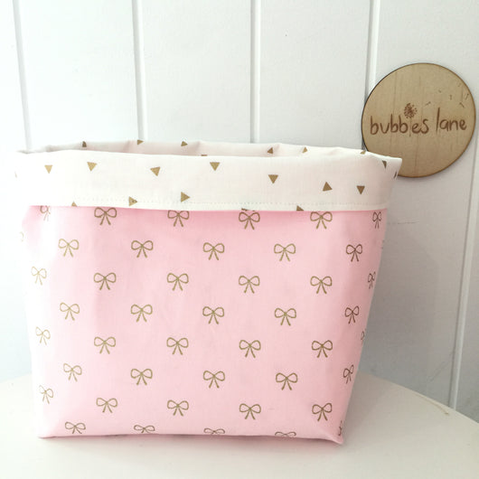 Pink bows with gold triangles fabric basket