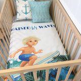 Surfer boy with blue dots cot quilt