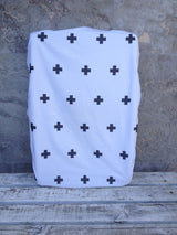 Tossed black triangle, white with black swiss cross, black with white small cross change sheet
