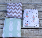 Grey chevron change sheet, mint pineapple change sheet, feather with triangle change sheet.