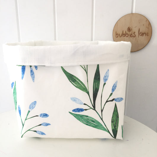 Blue branches with plain white linen fabric basket