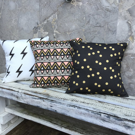 White with black lighting bolt, peach/gold/black tribal, black/gold dot cover
