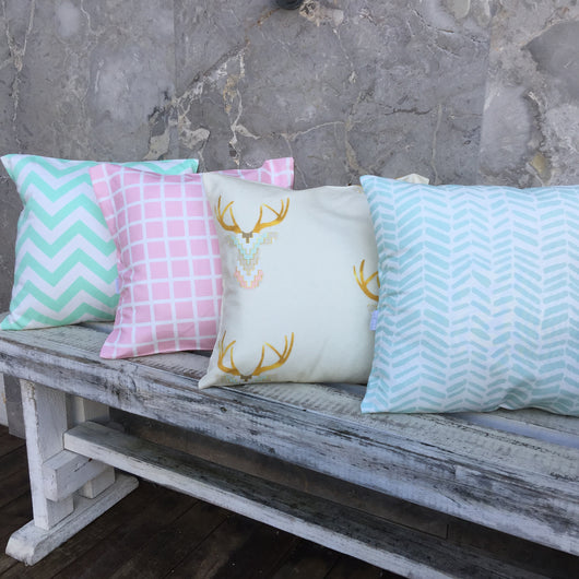 Mint chevron, pink grid, mint/peach/bone stag head, mint herringbone cushion covers
