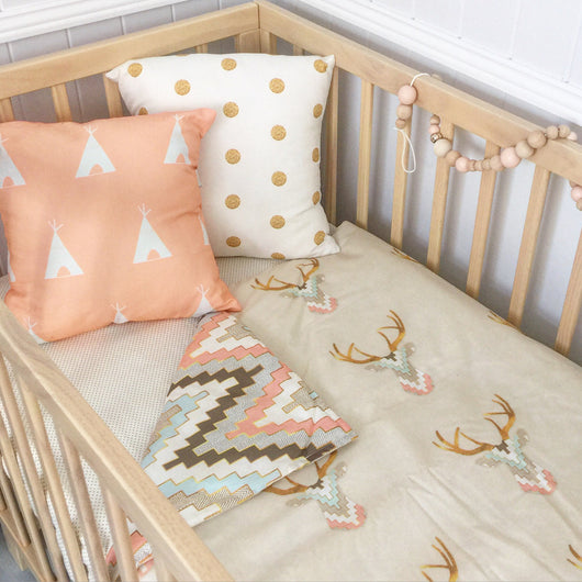 Bone/peach/mint stag head cot quilt with chevron
