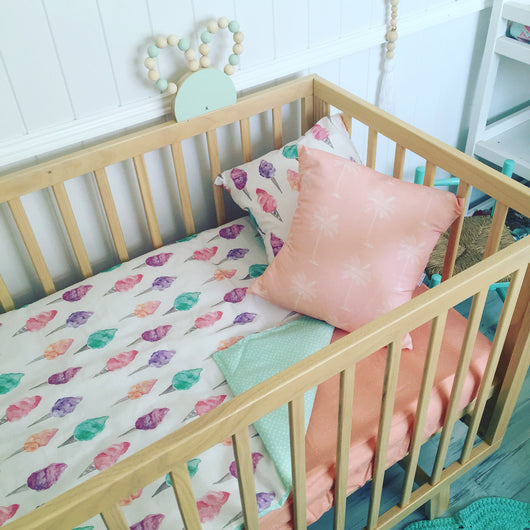 Fairy floss cot quilt with pink chevron