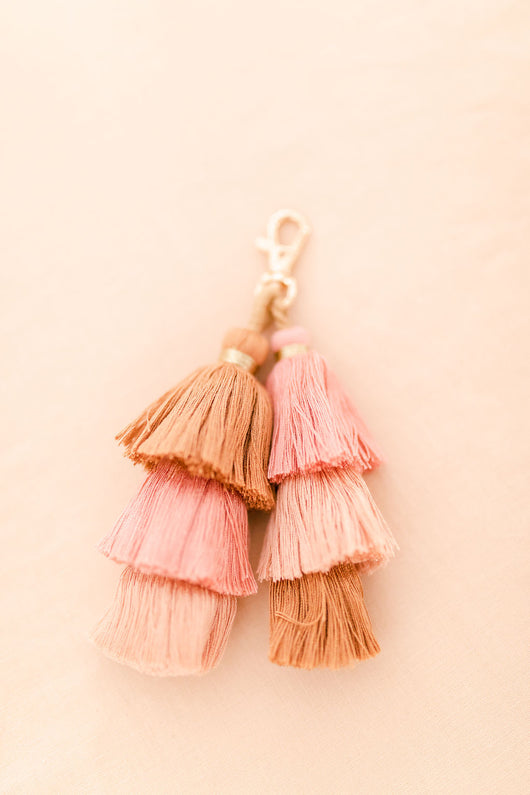 Pink and tan pom pom tassel