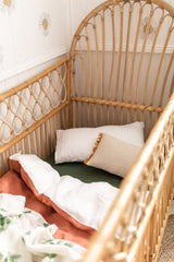 Stonewashed terracotta with white linen cot quilt
