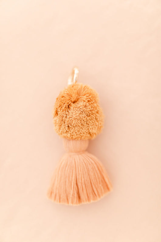 Peach and mustard pom pom tassel