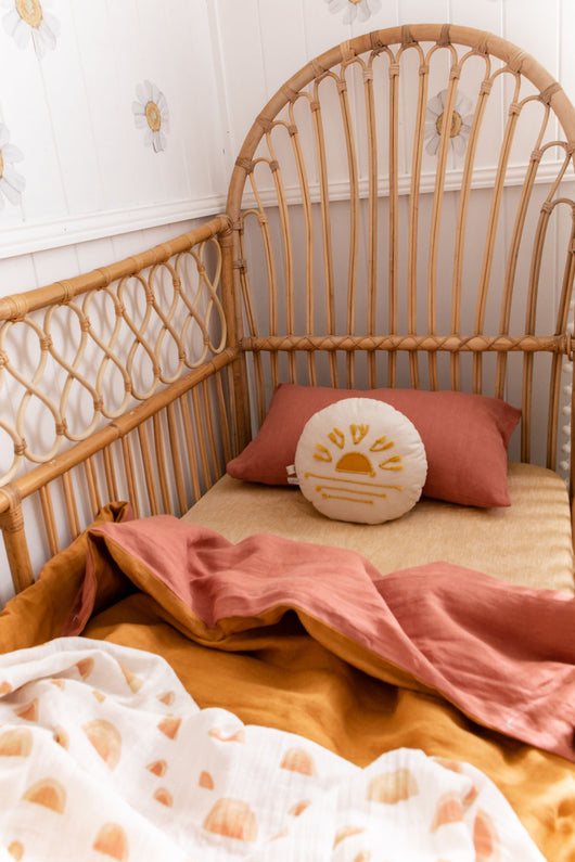 Stonewashed terracotta with stonewashed mustard linen cot quilt