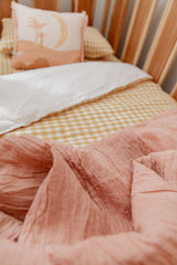 Yellow gingham linen with white linen cot quilt