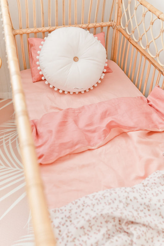 Peachy pink linen with blossom linen cot quilt