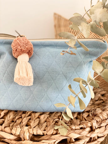 Blue quilted knit nappy clutch