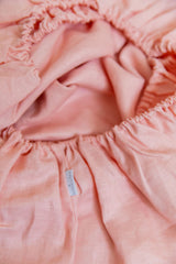 Peachy pink 100% linen cot sheet