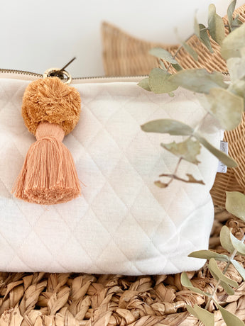 Ivory quilted knit nappy clutch