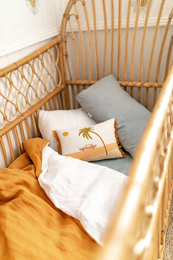 Stonewashed mustard linen with white linen cot quilt
