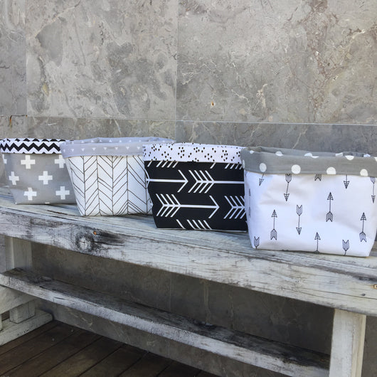 Grey cross, charcoal featherland, black arrow, white with black arrow fabric basket