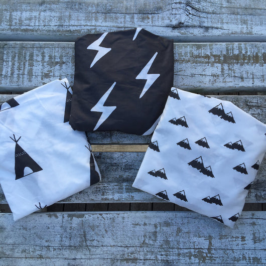 White with black teepee change sheet, charcoal lightning bolt change sheet