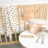 Peach/gold chevron cot quilt with gold dots