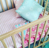 Mint with pink feather cot quilt with light pink chevron.