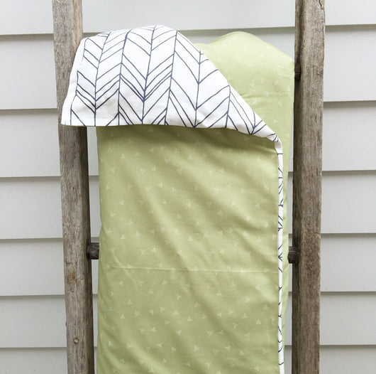 Olive green dotty triangle with navy herringbone