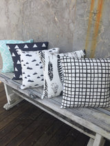 Mint Aztec, navy triangle, navy mountain, black feathers, black grid cushion cover