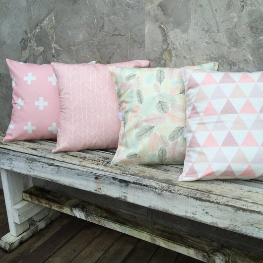 Pink cross, pink featherland, illustrated feather, pink textured triangle cushion cover