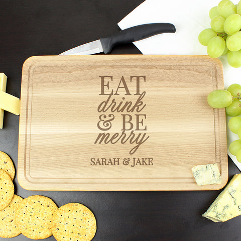 Buy Personalised Eat Drink & Be Merry Chopping Board £10.99 at Gift Moments