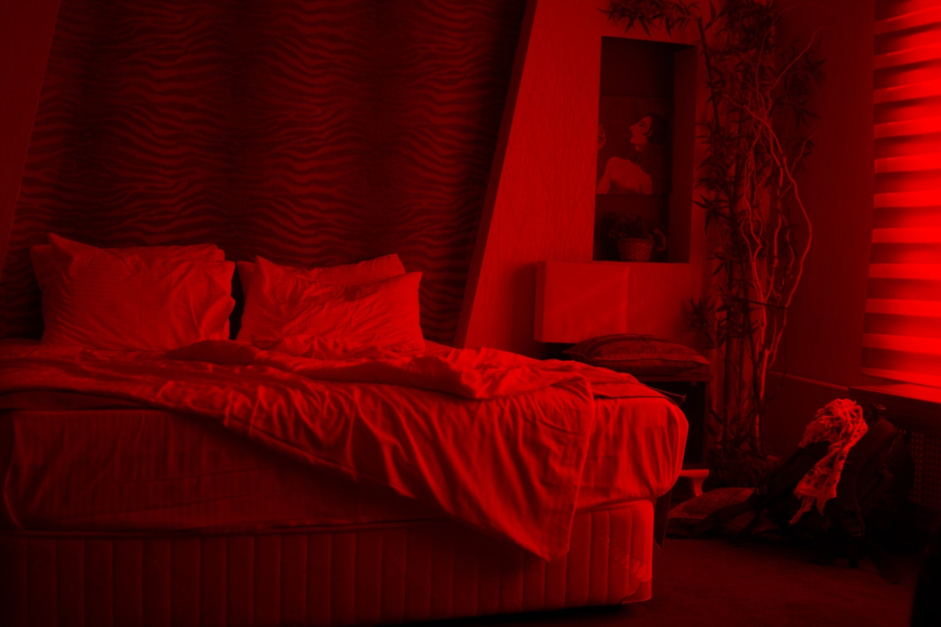 empty bed with red dim lights