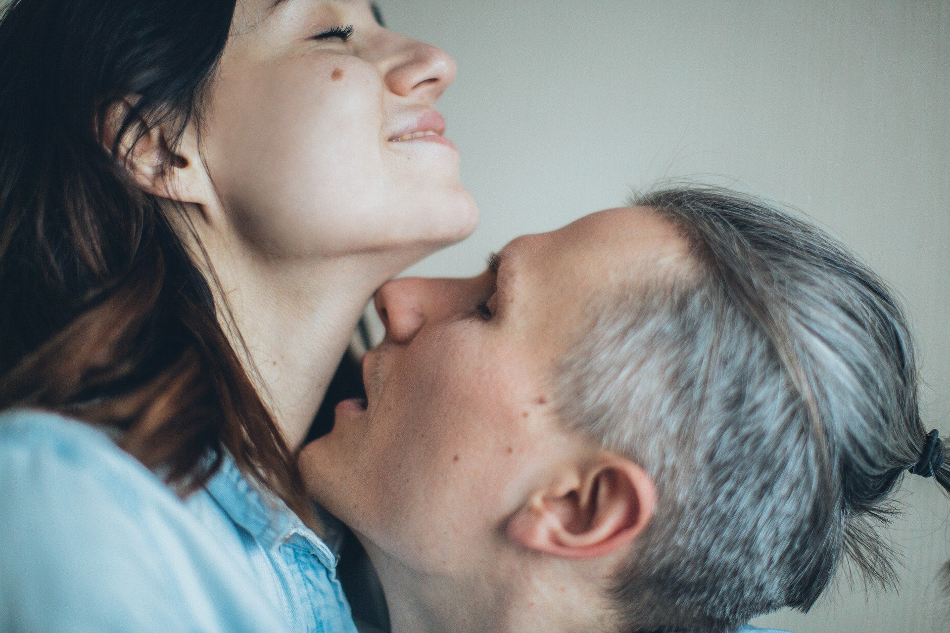 Intimate couple neck kissing