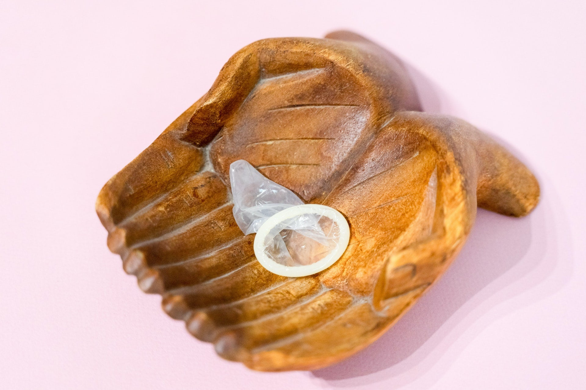 condom in a wooden hand