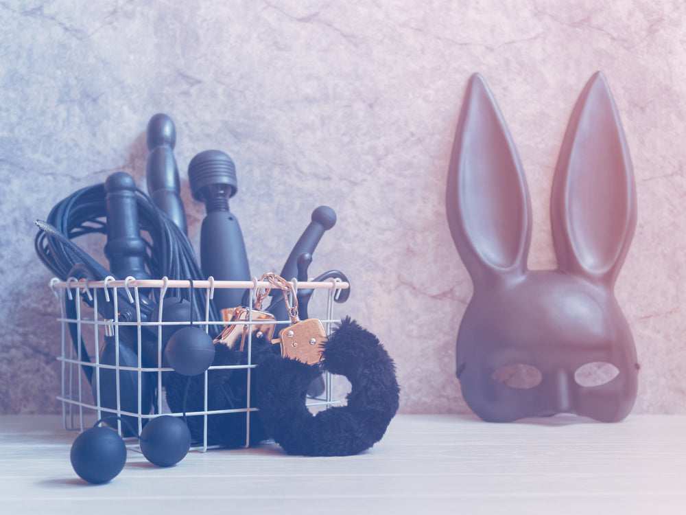 Different types of sex toys in a metal basket